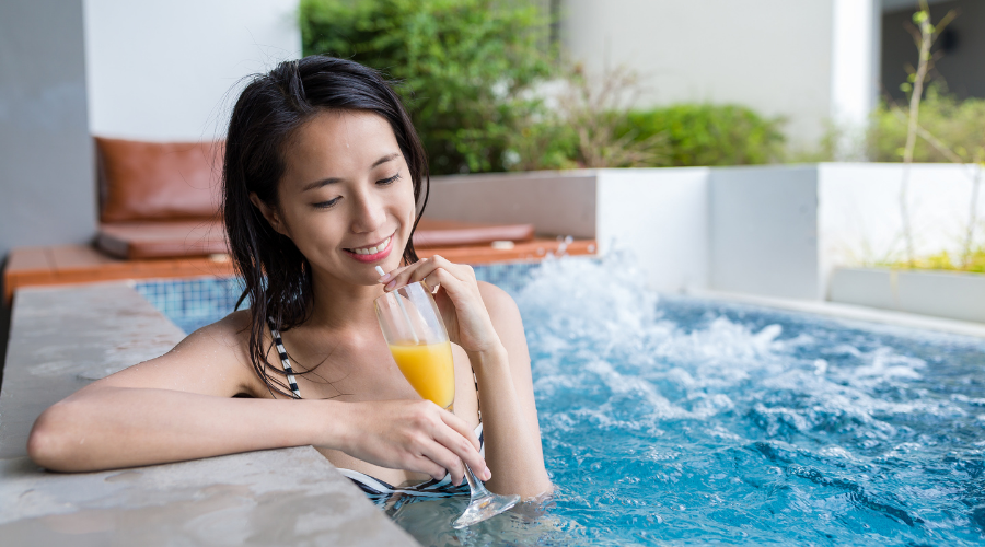 Woman drinking in hot tub
