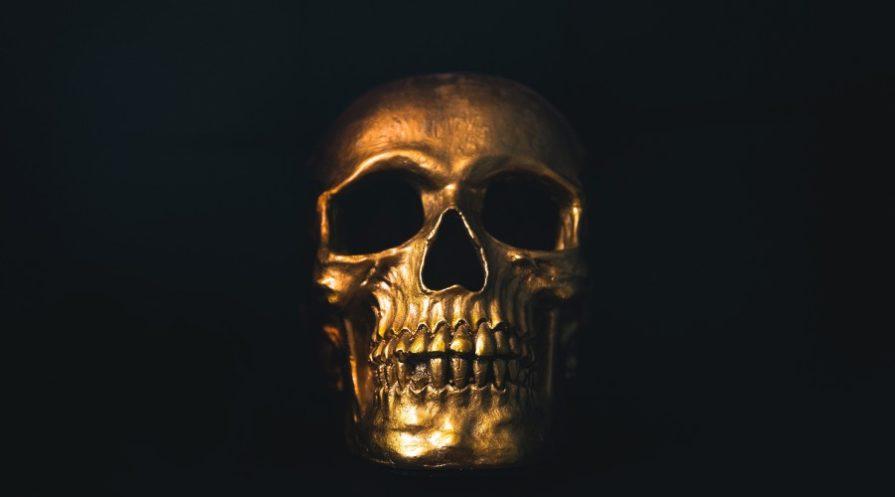 Golden skull on black background