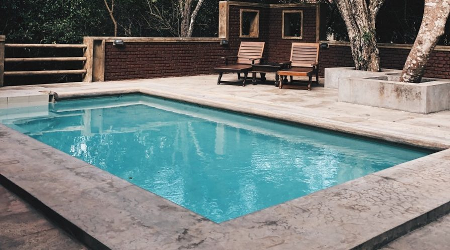 swimming pool and two chairs