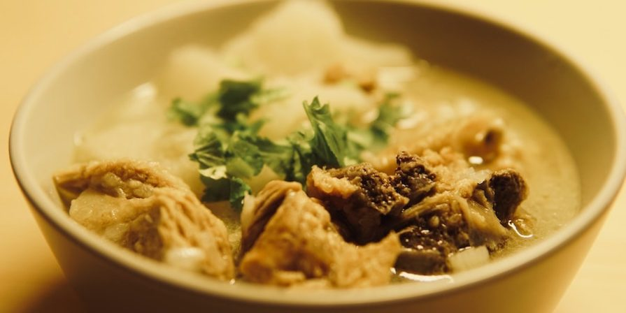Lamb stew in a bowl with rice