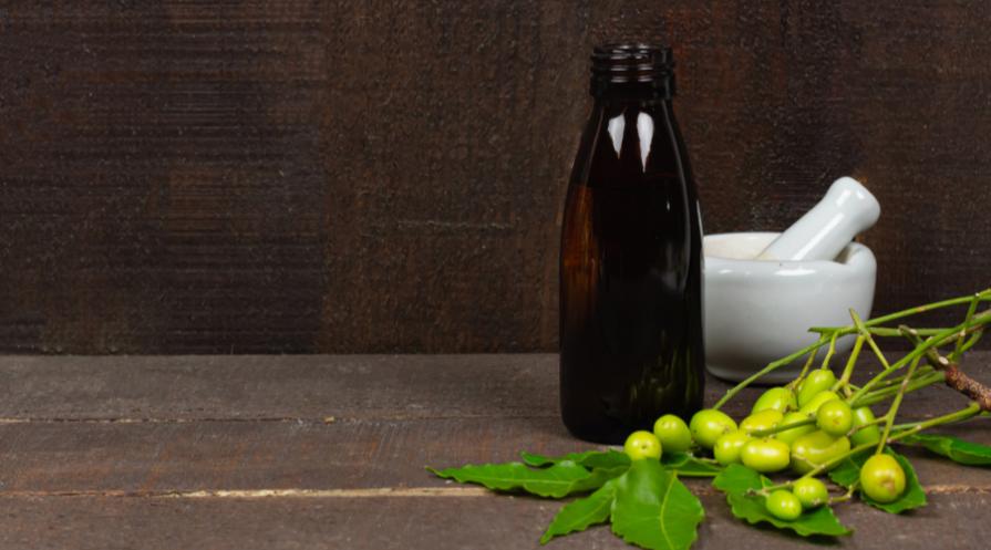 Homemade neem oil in bottle