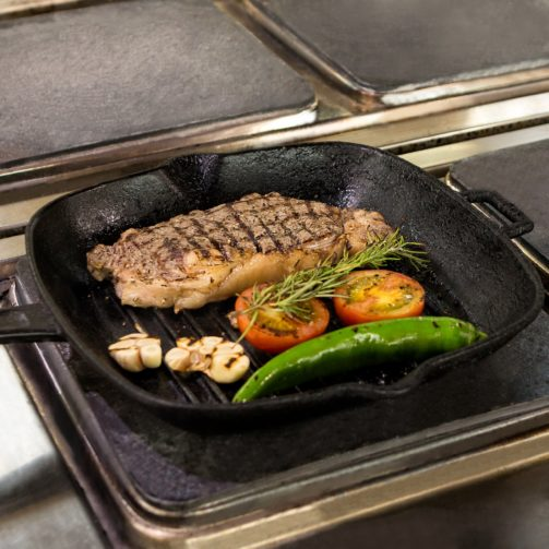 Grilling pan with meat and veggies on it