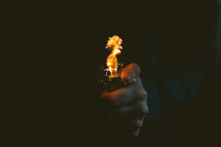 a man with the lighter