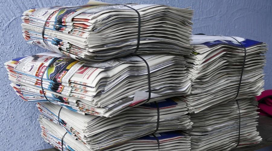 bound piles of newspaper
