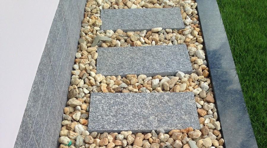 stepping stone pathway with garden landscape stones around it